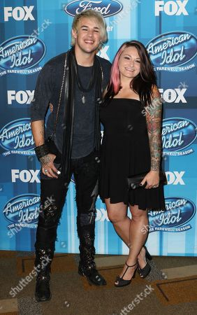 "James Durbin, left, and Heidi Lowe arrive at the ""American Idol"" farewell season finale at the Dolby Theatre, in Los Angeles"