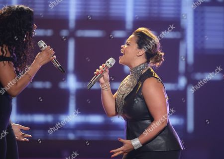 "Jordin Sparks, left, and Kimberley Locke perform at the ""American Idol"" farewell season finale at the Dolby Theatre, in Los Angeles"
