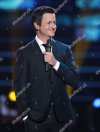 "Brian Dunkleman speaks at the ""American Idol"" farewell season finale at the Dolby Theatre, in Los Angeles"