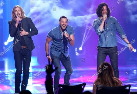 """Stock Image of Constantine Maroulis, from left, Ace Young and Bucky Covington perform at the """"American Idol"""" farewell season finale at the Dolby Theatre, in Los Angeles"""