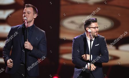 """Stock Photo of Clark Beckham, left, and Danny Gokey perform at the """"American Idol"""" farewell season finale at the Dolby Theatre, in Los Angeles"""