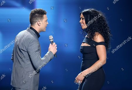 """Justin Guarini, left, and Jordin Sparks perform at the """"American Idol"""" farewell season finale at the Dolby Theatre, in Los Angeles"""