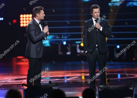 "Stock Photo of Ryan Seacrest, left, and Brian Dunkleman speak at the ""American Idol"" farewell season finale at the Dolby Theatre, in Los Angeles"