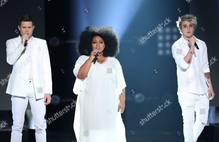 """Stock Picture of Trent Harmon, from left, La'Porsha Renae and Dalton Rapattoni perform at the """"American Idol"""" farewell season finale at the Dolby Theatre, in Los Angeles"""