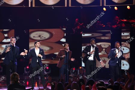 """Stock Picture of Clark Beckham, from left, Danny Gokey, Elliott Yamin, George Huff and Brandon Rogers perform at the """"American Idol"""" farewell season finale at the Dolby Theatre, in Los Angeles"""