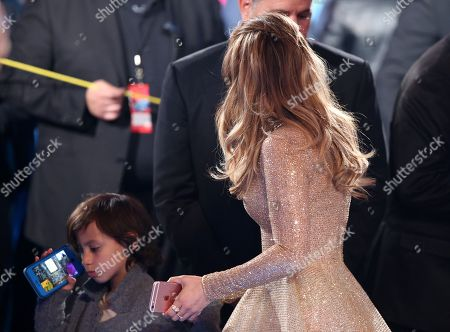 """Jennifer Lopez, right, and son Maximilian David Muniz appear at the """"American Idol"""" farewell season finale at the Dolby Theatre, in Los Angeles"""