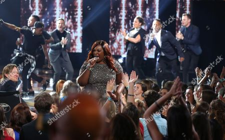 """Candice Glover performs at the """"American Idol"""" farewell season finale at the Dolby Theatre, in Los Angeles"""