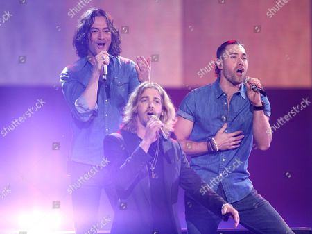 """Stock Picture of Constantine Maroulis, from left, Bucky Covington, Ace Young perform at the """"American Idol"""" farewell season finale at the Dolby Theatre, in Los Angeles"""