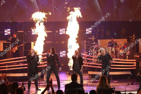 "Caleb Johnson, from left, Constantine Maroulis, Chris Daughtry, and James Durbin perform at the ""American Idol"" farewell season finale at the Dolby Theatre, in Los Angeles"