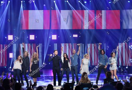 "Skylar Laine, from left, Bucky Covington, Lauren Alaine, Scotty McCreery, Kree Harrison, Ace Young, Kellie Pickler, Constantine Maroulis Diana DeGarmo perform at the ""American Idol"" farewell season finale at the Dolby Theatre, in Los Angeles"