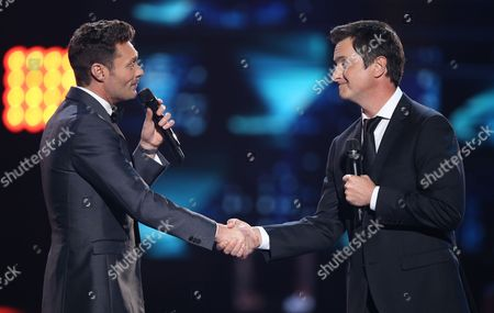 "Stock Picture of Ryan Seacrest, left, and Brian Dunkleman speak at the ""American Idol"" farewell season finale at the Dolby Theatre, in Los Angeles"
