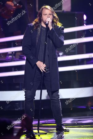 """Stock Photo of Caleb Johnson performs at the """"American Idol"""" farewell season finale at the Dolby Theatre, in Los Angeles"""