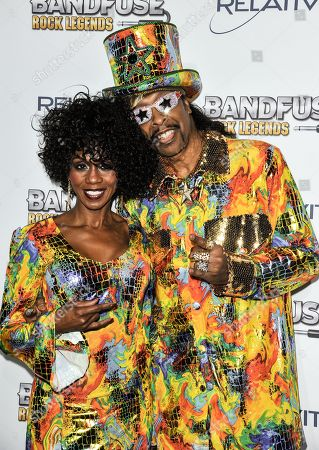"""Stock Photo of Patti Collins, left, and Bootsy Collins arrive at the """"Bandfuse: Rock Legends"""" video game launch at the House of Blues on in Los Angeles"""