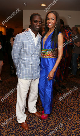 "From left, cast members Adesola Osakalumi and Michelle Williams pose during a reception for the opening night performance of ""Fela!"" at the Center Theatre Group/Ahmanson Theatre on in Los Angeles, Calif"