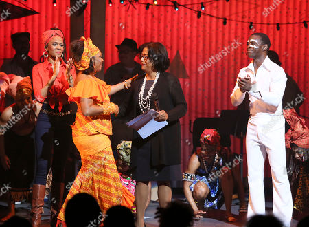"Stock Photo of From left, cast member Michelle Williams, Yeni Kuti, Fela's oldest daughter, Councilwoman Jan Perry and cast member Adesola Osakalumi during the curtain call for the opening night performance of ""Fela!"" at the Center Theatre Group/Ahmanson Theatre on in Los Angeles, Calif"