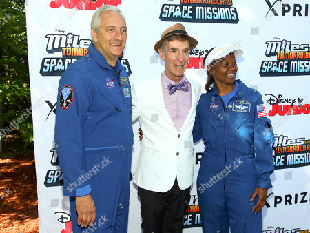 "Mike Massimino, from left, Bill Nye and Yvonne Cagle attend the Disney Junior and XPRIZE launch of ""Miles from Tomorrowland: Space Missions"" at the New York Hall of Science, in New York"