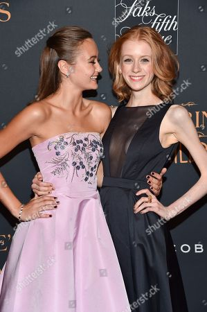 """Actresses Ella Purnell, left, and Lauren McCrostie attend """"Miss Peregrine's Home for Peculiar Children"""" red carpet event at Saks 5th Avenue, in New York"""