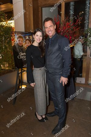 """Mark Steines, right and Leanza Cornett attend a screening for Hallmark Movies & Mysteries """"Operation Christmas"""" at The Gove on in Los Angeles"""