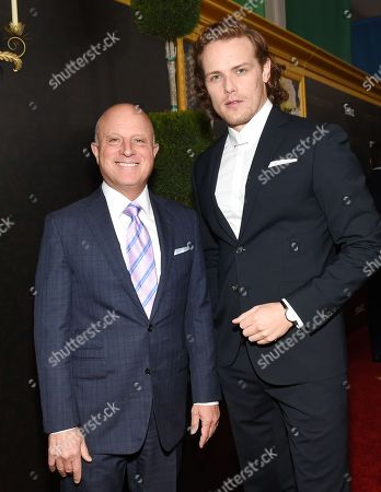 """Starz CEO Chris Albrecht, left, and actor Sam Heughan attend the """"Outlander"""" Book Two world premiere and after party at the American Museum of Natural History, in New York"""