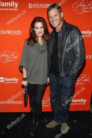 "Stock Picture of Actors Laura Leighton and husband / actor Doug Savant arrive at the ""Pretty Little Liars"" screening of a special Halloween episode at the Hollywood Forever Cemetery on in Los Angeles"