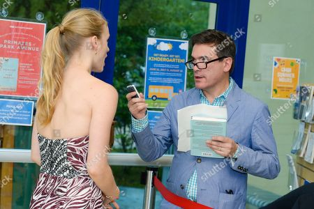 """Stock Photo of Jeffrey Slonim, right, Leven Rambin at the """"Primates Of Park Avenue"""" book release event at the Children's Museum of the East End in Bridgehampton, in New York"""