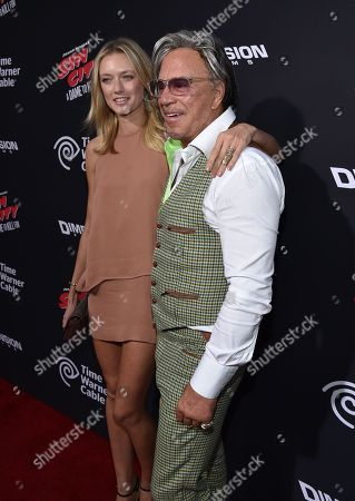 """Anastassija Makarenko, left, and Mickey Rourke arrive at the """"Sin City: A Dame to Kill For"""" premiere presented by Dimension Films in partnership with Time Warner Cable, Dodge and DeLeon Tequila at TCL Chinese Theatre, in Los Angeles"""