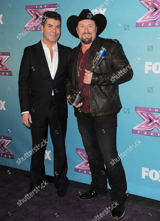 "Tate Stevens, winner of ""X Factor"" season 2, right, and Simon Cowell attend the season finale results show at CBS Television City, in Los Angeles"
