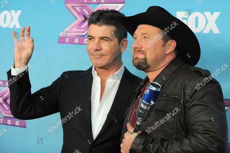 "Tate Stevens, right, and Simon Cowell attend the ""The X Factor"" season finale results show at CBS Television City, in Los Angeles"