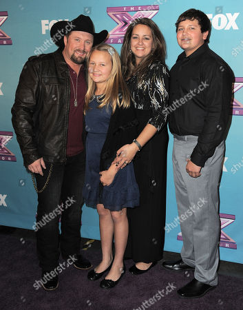 "Tate Stevens and his family attend the ""The X Factor"" season finale results show at CBS Television City, in Los Angeles"