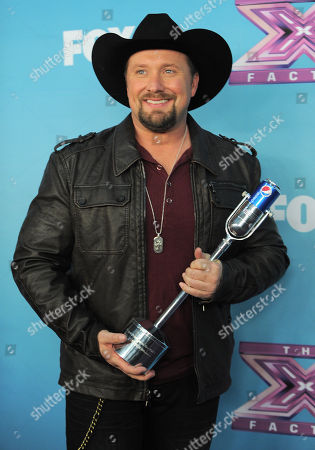 "Tate Stevens attends the ""The X Factor"" season finale results show at CBS Television City, in Los Angeles"