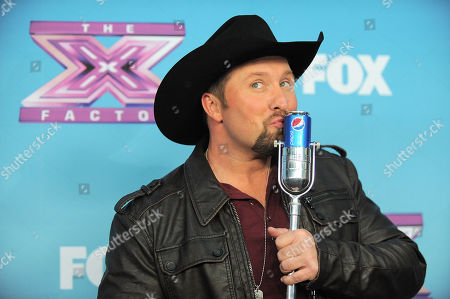 "Tate Stevens, winner of ""X Factor"" season 2, attends the season finale results show at CBS Television City, in Los Angeles"