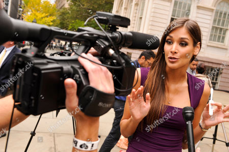 Former Miss Universe Dayana Mendoza shows the press the OraQuick In-Home HIV Test at New York City Hall on the 10th Annual National Latino HIV/AIDS Awareness Day, in New York