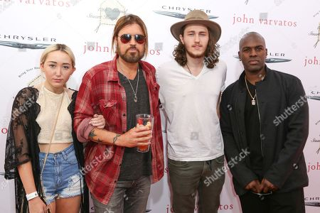 Noah Cyrus, from left, Billy Ray Cyrus, Braison Cyrus and Corey Gamble arrive at the 12th Annual John Varvatos Stuart House Benefit at John Varvatos Boutique, in West Hollywood, Calif