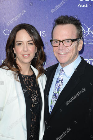 Tom Arnold, at right, and Ashley Groussman arrives at The 13th Annual Chrysalis Butterfly Ball at Brentwood County Estates, in Los Angeles, CA