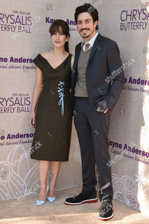 Stock Picture of Michelle Mulitz, left and Ben Feldman arrive at the 14th Annual Chrysalis Butterfly Ball held at the residence of Susan Harris and Hayward Kaiser, in Los Angeles