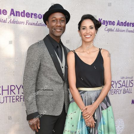 Aloe Blacc, left, and Maya Jupiter arrive at the 14th Annual Chrysalis Butterfly Ball held at the residence of Susan Harris and Hayward Kaiser, in Los Angeles