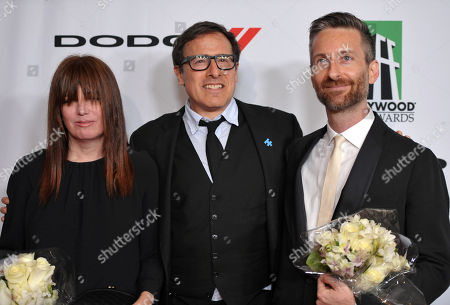 From left, Judy Becker, David O'Russell, and Michael Wilkinson arrive at the 17th Annual Hollywood Film Awards Gala at the Beverly Hilton Hotel, in Beverly Hills, Calif