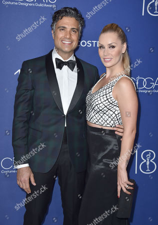 Jaime Camil, left, and Heidi Balvanera arrive at the 18th annual Costume Designers Guild Awards at the Beverly Hilton hotel, in Beverly Hills, Calif