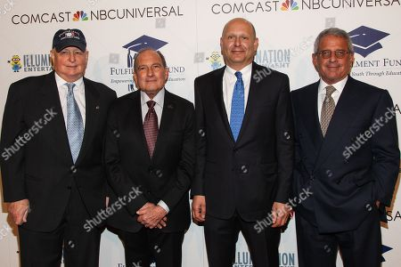 From left, Tom Sherak, Fullfilment Fund founder Gary Gitnick, M.D., Illumination Entertainment Founder and CEO, Chris Meledandri, and Vice Chairman of NBCUniversal Ron Meyer arrive at the 19th Annual Fulfillment Fund Stars Benefit Gala 2013 at the Beverly Hilton Hotel on in Beverly Hills, Calif