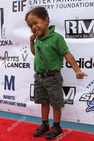 Actor Elias Washington attends the 1st Annual Athletes vs. Cancer Celebrity Flag Football game at the Palisades High School on in Pacific Palisades, Calif