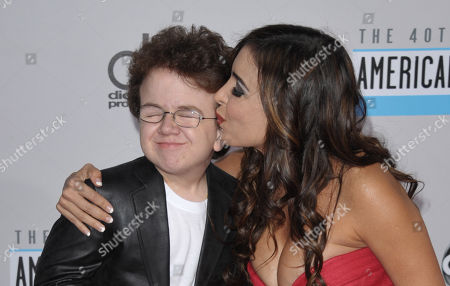 Stock Image of Keenan Cahill, left, and Mayra Veronica arrive at the 40th Anniversary American Music Awards, in Los Angeles