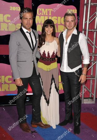 From left, Tom Gossin, Rachel Reinhart and Mike Gossin of Gloriana arrive at the 2012 CMT Music Awards on in Nashville, Tenn
