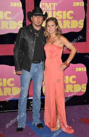 Jason Aldean, left, and Jessica Aldean arrive at the 2012 CMT Music Awards on in Nashville, Tenn