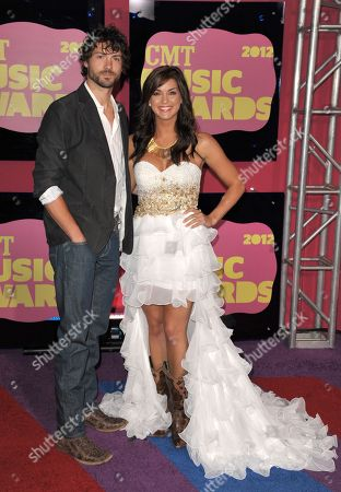 Stock Image of Jeremiah James Korfe, left, and Paige Duke arrive at the 2012 CMT Music Awards on in Nashville, Tenn