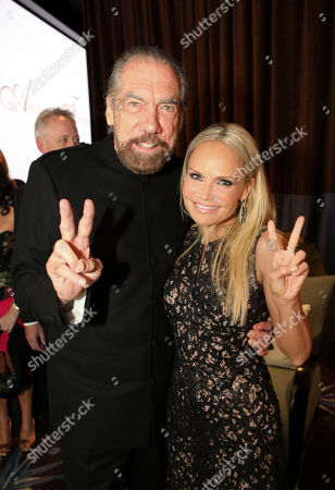 From left, John Paul DeJoria and host Kristen Chenoweth pose during 2012 American Humane Association Hero Dog Awards held at the Beverly Hilton Hotel, in Los Angeles, Calif