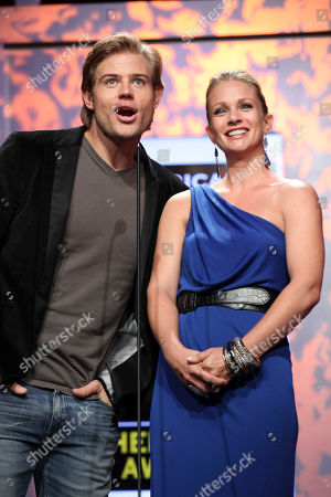From left, actors Trevor Donovan and AJ Cook present during 2012 American Humane Association Hero Dog Awards held at the Beverly Hilton Hotel, in Los Angeles, Calif