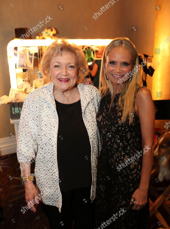 From left, actresses Betty White and Kristen Chenoweth pose during 2012 American Humane Association Hero Dog Awards held at the Beverly Hilton Hotel, in Los Angeles, Calif