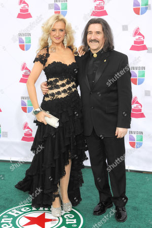Patricia Cobos, left, and Luis Cobos arrive at the 13th Annual Latin Grammy Awards at Mandalay Bay, in Las Vegas