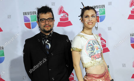"""Jorge """"Chiquis"""" Amaro, left, and Maria Barracuda, of the musical group JotDog, arrive at the 13th Annual Latin Grammy Awards at Mandalay Bay, in Las Vegas"""