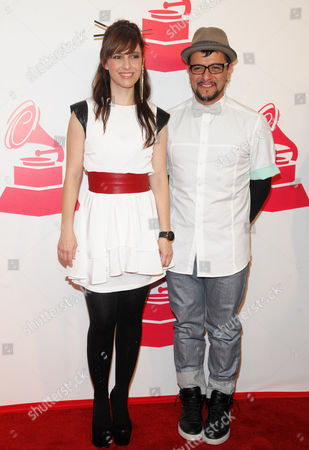 """Maria Barracuda, left, and Jorge """"Chiquis"""" Amaro, of musical group JotDog, arrive at the 2012 Latin Recording Academy Person of the Year Tribute to Caetano Veloso at the MGM Grand Garden Arena, in Las Vegas"""